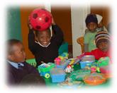Children enjoying Shuters gifts at a creche in Pietermaritzburg in 2013